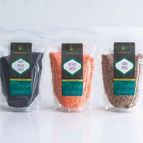 Red, green, and black lentils in gusset bags