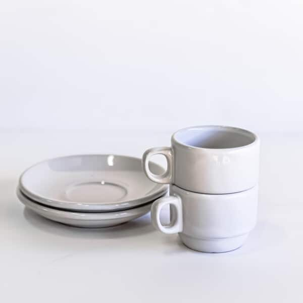 Set of two white espresso cups stacked
